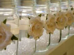 I love the flowers on the mason jars tied on with ribbon (or you could use double sided tape). Good use for centerpieces with a tight floral budget.