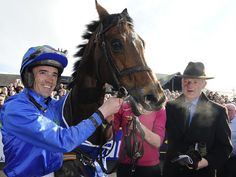 Ruby Walsh, Hurricane Fly and Willie Mullins, after winning the Irish Champion Hurdle.Connections were delighted with the 16-time Grade One winner
