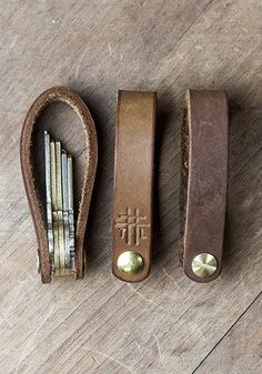 """The Foldover Fob is a simple way to ORGANIZE AND SILENCE keys, using hand-tooled leather, combining style with function."":"