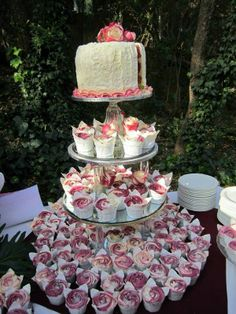 Cake ideas.                                        Cupcake wedding cake. Except blue and purple instead.