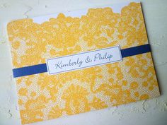 I like the lace and first names on the front of the invitation