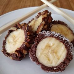 "Chocolate peanut butter ""sushi"" bites -1 large firm banana -4 tablespoons all natural peanut butter -1 1/2 tablespoons unsweetened cocoa -1/4 teaspoon vanilla extract -1 1/2 tablespoon honey Combine ingredients well, spread on banana, cover in chopped nuts or coconut, then slice. Eat using chopsticks!"