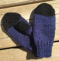 These are hand knit mittens. The toddler mittens are knit on four needles instead of two like most, making them seamless and comfortable. Traditionally knit mittens are knit on two needles and then sewn with a seem and the thumbs are both the same and only ironed over. These are actually knit as a right and a left with opposing thumbs and have no seam. These mittens are knit with a soft acrylic yarn in blue and black. They are ideal fro small outings and shopping trips.  These mitts make an e... Toddler Mittens, Knit Mittens, Fingerless Gloves, Arm Warmers, Hand Knitting, Trips, Sewing, Blue, Shopping