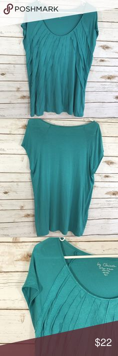 Chicos Textured Tee Shirt Rayon Size 3 / XL Chicos Testured Scoop NeckTee, Teal Blue Chico's Size 3 which is an XL in other brands Measures: 22 inches across from armpit to armpit Measures: 26 inches from shoulder to hemline  95% Rayon 5% Spandex Super soft and light weight! Chico's Tops Tees - Short Sleeve