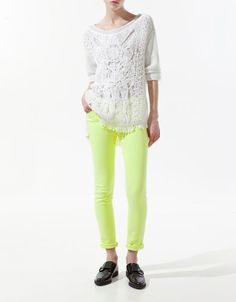Sweater with macrame front and neon jeans from Zara