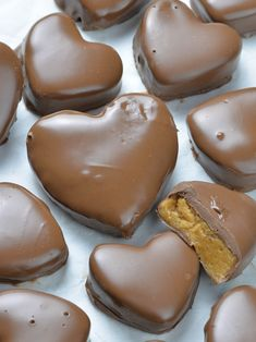 Bunch of Reeses Peanut Butter Valentines Hearts on white background.