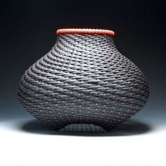 A Japanese twill woven basket, dyed with iron oxide dye, henna and madder. The dots are layered three to four times to make them pop. The