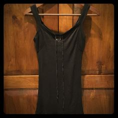 NWT Free People tank Super soft semi-sheer black tank with cinch tie in the front. Hem sits just below hips. Free People Tops Tank Tops