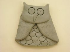 Flat clay owl - begin with a pancake, add texture, fold in wings, fold head down, more texture/eyes/beak.  Hole in back to hang.  Could glue wire feet on later.  Cute, lots of good clay techniques.