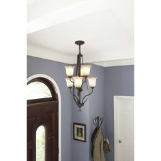 A traditional light fixture in an oil-rubbed bronze provides a warm welcome home. Elegant details illuminate and add sophistication to your room.