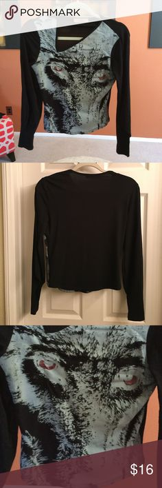 Vintage Goth Top Super fun and unique vintage gothic top, with a cool angled v-neck, distorted graphic face., red glittery eyes, and long sleeves with a puff elbow. This top is made in France, brand is An'ge. I don't know the exact size, would probably fit a Size S/M or Med. I will list it as such. I love this top, but it's too small for me. Previously loved, but in good condition 😍 An'ge Tops
