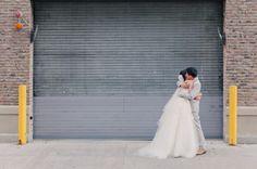a pre-ceremony hug on the streets of NY  Photography by mademoisellefiona.com