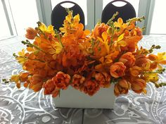 An orange and grey wedding at Pier Wisconsin...Modern. Chic. Timeless. Florals by Stephanie McCready