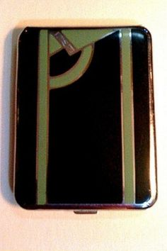 Art Deco stainless steel cigarette case, ca.1930-40. Dark green enamel with lighter green Deco design (please follow minkshmink on pinterest)