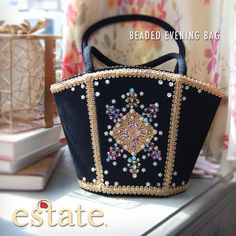 Estate West Grand - Beaded Evening Bag. Black felt evening bag with gorgeous gold trim and beading in blues, purples and pinks. Exquisitely feminine and elegant for a night on the town. $50.