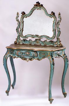 Vanity for a Rococo bedroom. It fits with Rococo style because it is a soft pastel blue color which is typical of the style, as most colors during this time were light and happy. It also incorporates leafy motifs which are present in all Rococo pieces.