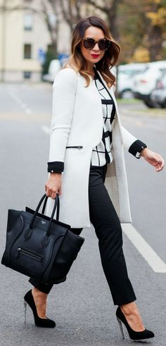 Street fashion coat, heels, handbag and shades.