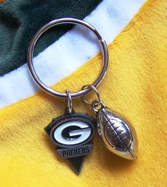 Hey, I found this really awesome Etsy listing at https://www.etsy.com/listing/122459042/green-bay-packer-football-key-ring