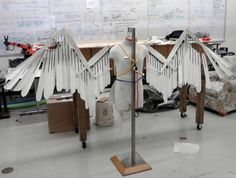 Picture 1 of my folding Victorian wings. The wings open and close through a set of pull cords and pulleys located in the front. Design was loosely based on various cosplay wings as well as Davinci'...