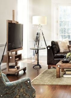 Arhaus Catalog- love this tv stand that looks like an artist's easel-awesome!