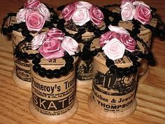 Altered wooden thread spools - great idea for place card holders.