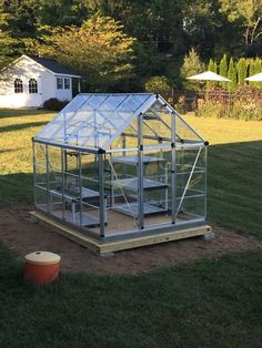 Palram Snap and Grow 6 ft. x 8 ft. Silver Polycarbonate Greenhouse 701273 at The Home Depot - Mobile Diy Greenhouse Plans, Greenhouse Supplies, Cheap Greenhouse, Backyard Greenhouse, 6x8 Greenhouse, Greenhouse Farming, Homemade Greenhouse, Growing Plants Indoors, Grow Lights For Plants