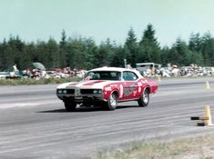 Pete Kost driving the Smothers Brothers/Dewey-Griffin 1969 4-4-2 W-30 convertible