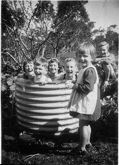 """Cousins at their grandparents enjoying a dip in the """"swimming pool"""" - Mount Kuring-gai, NSW, no date by State Library of New South Wales collection. Old Pictures, Old Photos, Kiddie Pool, My Childhood Memories, The Good Old Days, Vintage Photographs, Back In The Day, Beach Trip, Vintage Children"""