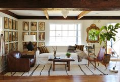 Ceiling beams, windows, neutral rug