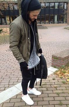 olive bomber. black zipper hoodie. long grey tee. black sweats. white sneakers. black beanie. black fingerless gloves.