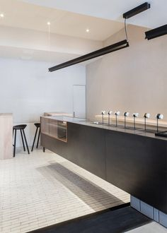 London creative agency Studio Mills has completed a Manhattan store for online watch brand Larsson & Jennings, featuring a cantilevered display