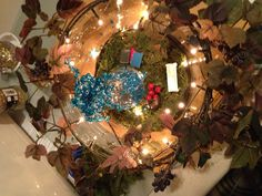 My expanded fairy garden in a larger dish with grape vine ivy and lights all complements of Crafts 2000