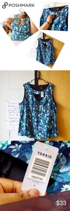 Floral Sateen Peplum Top - TORRID Super sexy teal top with a cut-out on the chest designed to show off a little cleavage. 😘 Details: floral print, zip-up back, and peplum shape to flatter any figure. ***NEW WITH TAGS*** Never worn, except to take these pics so you can see how yummy this top looks on! Size 4X. Make me an offer, I don't bite 💕 torrid Tops