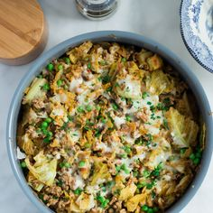 Ground Turkey Cabbage Skillet Recipe Main Dishes with onions, olive oil, lean ground turkey, cabbage, tomato sauce, vegetable broth, salt, pepper, frozen peas, mozzarella cheese, fresh parsley