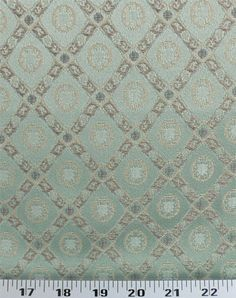 Medium Weight Drapery / Medium Weight Upholstery This small-scale jacquard diamond print with medallions is a great chair pattern. Pattern is light neutral shades (ivory, gold, beige, tan) .