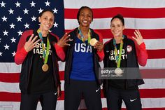 Diana Taurasi #12, Tamika Catchings #10 and Sue Bird #6 of the USA Basketball Women's National Team pose after winning the Gold Medal at the Rio 2016 Olympic games on August 20, 2016.