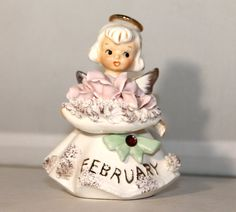 Lefton Angel Figurine February Birthday by Antiqueish on Etsy, $23.00 (So..I'm getting old...these were popular when I was little; I had one!)