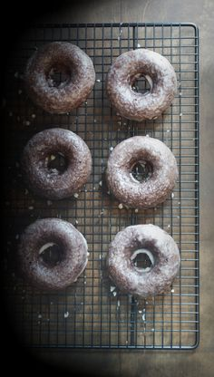 Baked Chocolate Glazed Donuts - These donuts are so chocolatey, moist and delicious! You'd never know they were baked! | @tasteLUVnourish | #donuts #doughnuts #chocolate