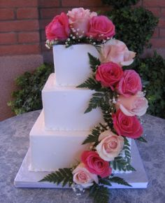 I love a square cake with flowers AND monogrammed...