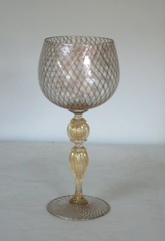 Murano glass goblet with avventurina reticello. Estate, castle still drinking chocolate milk but will look fabulous! Crystal Glassware, Antique Glassware, Crystal Vase, Murano Glass, Venetian Glass, Vintage Wine Glasses, Glass Artwork, Italian Art, Drinking Glass