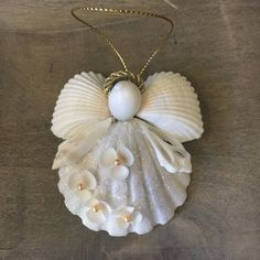 Floral Angel - Floral Angel Our Artist Angels are all Unique and handmade here at Sea Things in Ventura CA. Seashell Christmas Ornaments, Angel Ornaments, Ornament Crafts, Christmas Angels, Christmas Crafts, Beach Ornaments, Beach Christmas Trees, Halloween Crafts, Seashell Art