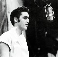 """Elvis recording the title song for his first movie Love Me Tender at the """"20th- Century Fox' sound stage, August 24, 1956"""