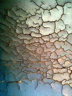 Moment. Crack. This photo of peeled paint has many cracks and lines in it from being old and chipped