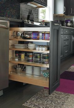 Avoid wasting space and cluttering cabinets by adding Decora's spice pullout cabinet to your kitchen.