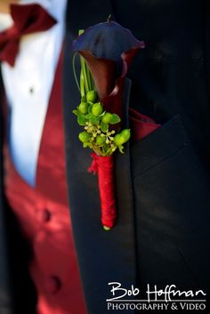 Simple calla lily boutonnière with red bow tie for a winery wedding!