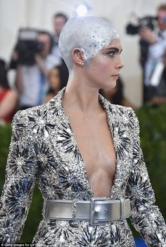 Silver stunner: Her jewelled suit was typically bold