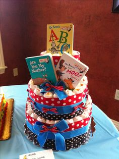 Diaper cake made for a Dr Seuss themed baby shower. It was almost impossible to find Dr Seuss toys so I did the books and colors.
