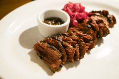 Simple hanger steak (sous vide with a light sear.) Served rare with black pepper oil and pickled red cabbage.