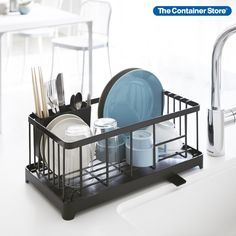Sleek lines and rugged construction make this dish rack a kitchen essential. Its steel wire frame provides a secure hold for air-drying plates, bowls and drinkware. A cutlery holder keeps contents upright for spot-free drying, then detaches so you can carry everything to the utensil drawer for easy removal. Below, the drip tray includes a drainage spout that directs water directly to your sink. Countertops stay neat and dry. Home Decor Kitchen, Home Decor Bedroom, Kitchen Interior, Kitchen Design, Design Japonais, Dish Drainers, Dish Racks, Beds For Sale, Pottery Barn Teen