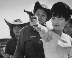 South Vietnam's Madame Nhu fires a pistol during a 1962 visit to an officer training session of the women's paramilitary force that she organized the year before.  Read more: Madame Nhu: The Polarizing Face of Vietnam   LIFE.com http://life.time.com/history/madame-nhu-polarizing-face-of-vietnam/#ixzz39875hALf